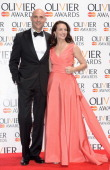 Mark Stong and Kristin Davis during the Laurence Olivier Awards at the Royal Opera House on April 13 2014 in London England