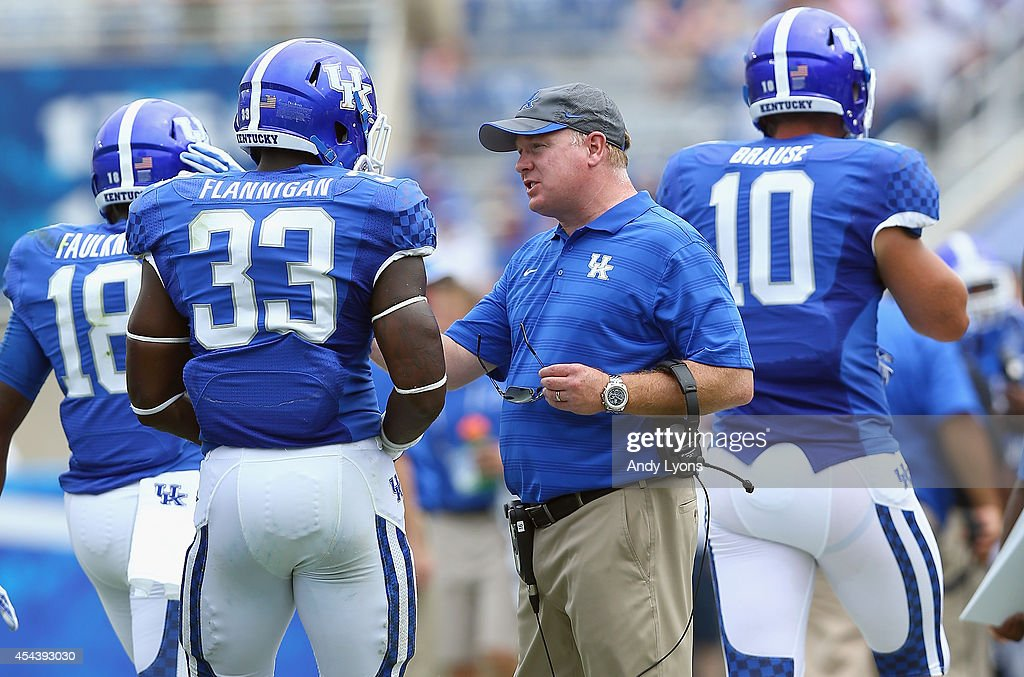 <a gi-track='captionPersonalityLinkClicked' href=/galleries/search?phrase=Mark+Stoops&family=editorial&specificpeople=4957711 ng-click='$event.stopPropagation()'>Mark Stoops</a> the head coach of the Kentucky Wildcats talks with Ryan Flannigan #33 during the game against the Tennessee- Martin Skyhawks at Commonwealth Stadium on August 30, 2014 in Lexington, Kentucky.