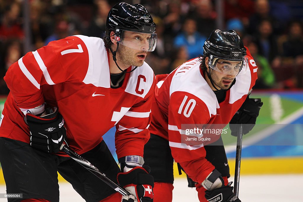 Mark Streit and Andres Ambuhl of Switzerland look on during the ice hockey Men's Qualification Playoff game between Switzerland and Belarus on day 12...