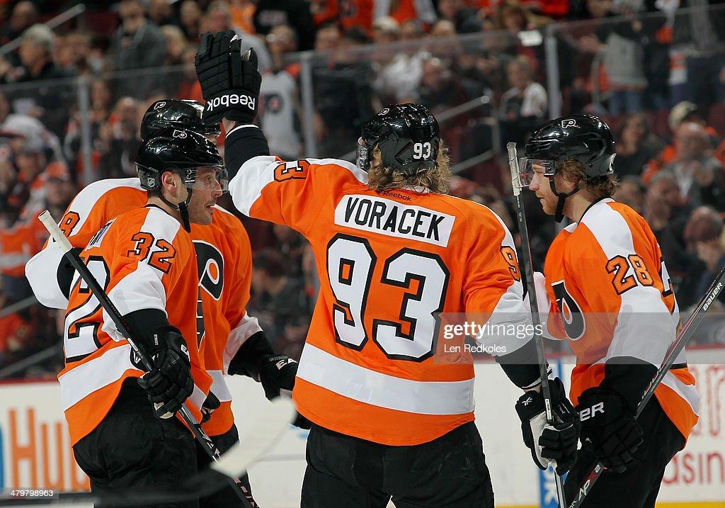 Mark Streit Nicklas Grossmann Jakub Voracek and Claude Giroux of the Philadelphia Flyers celebrate Streit's first period goal against the Dallas...
