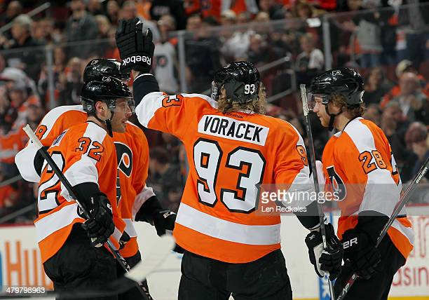 Mark Streit Nicklas Grossmann Jakub Voracek and Claude Giroux of the Philadelphia Flyers celebrate Streit's first period goal against the Dallas...