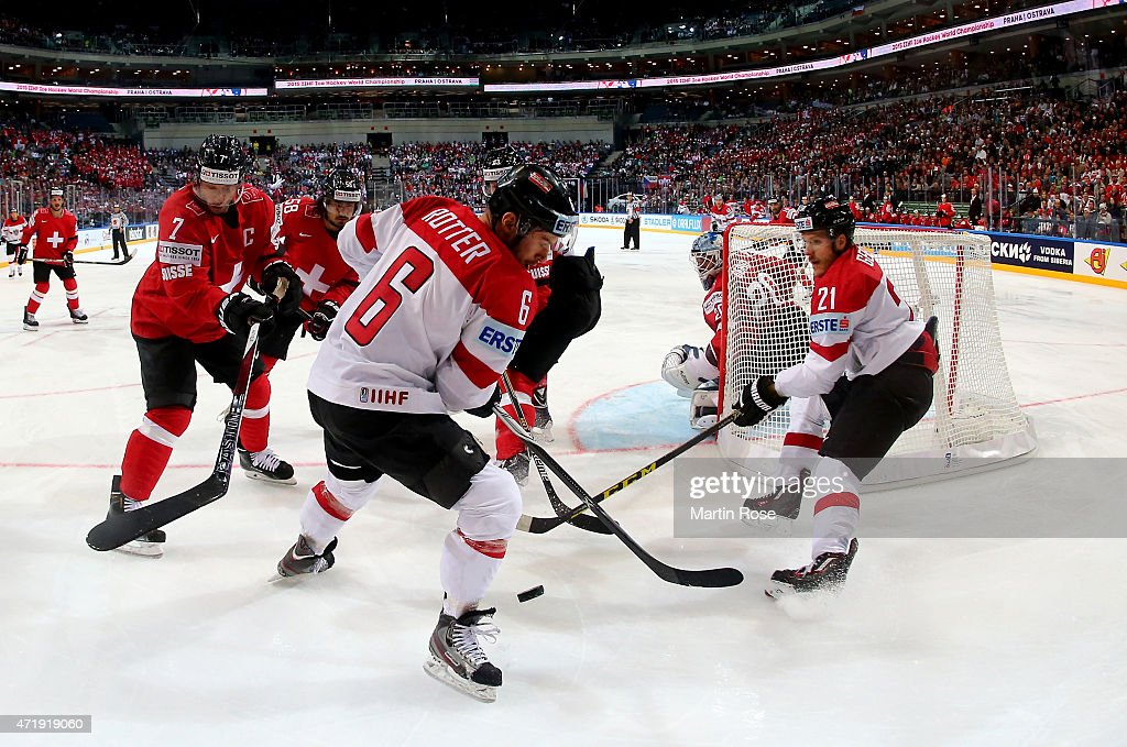 Mark Streit (L) of Switzerland and Rafael Rotter (R) of Austria battle for the puck during the IIHF World Championship group A match between Switzerland and Austria at o2 Arena on May 2, 2015 in Prague, Czech Republic.