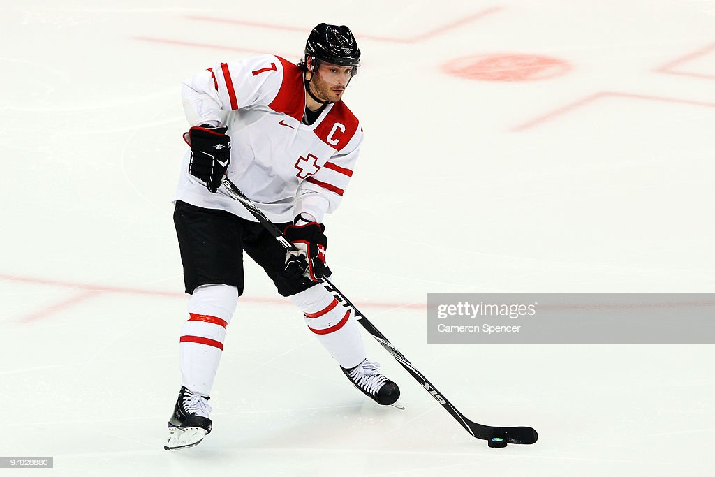 Mark Streit of Switzerland handles the puck during the ice hockey men's quarter final game between USA and Switzerland on day 13 of the Vancouver...