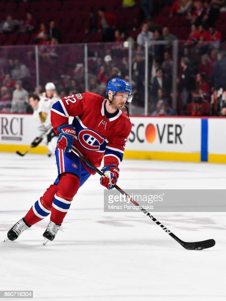 Mark Streit of the Montreal Canadiens skates the puck in the warmup against the Chicago Blackhawks during the NHL game at the Bell Centre on October...