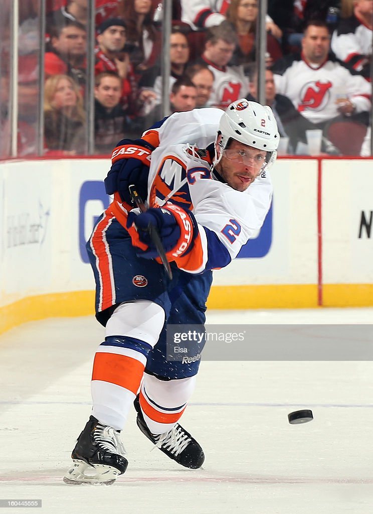 <a gi-track='captionPersonalityLinkClicked' href=/galleries/search?phrase=Mark+Streit&family=editorial&specificpeople=636976 ng-click='$event.stopPropagation()'>Mark Streit</a> #2 of the New York Islanders clears the puck in the third period against the New Jersey Devils at the Prudential Center on January 31, 2013 in Newark, New Jersey.The New York Islanders defeated the New Jersey Devils 5-4 in overtime.
