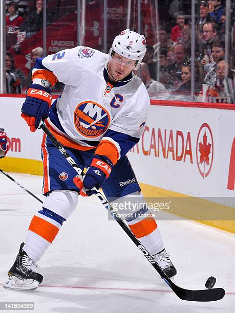 Mark Streit of the New York Islanders handles the puck during the NHL game against the Montreal Canadiens on March 17 2012 at the Bell Centre in...