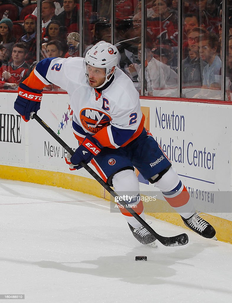 <a gi-track='captionPersonalityLinkClicked' href=/galleries/search?phrase=Mark+Streit&family=editorial&specificpeople=636976 ng-click='$event.stopPropagation()'>Mark Streit</a> #2 of the New York Islanders oplays the puck against the New Jersey Devils during the game at the Prudential Center on January 31, 2013 in Newark, New Jersey.