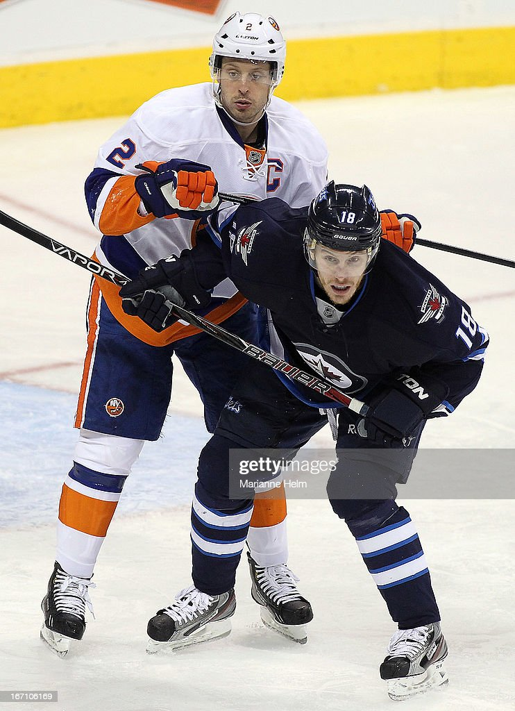 <a gi-track='captionPersonalityLinkClicked' href=/galleries/search?phrase=Mark+Streit&family=editorial&specificpeople=636976 ng-click='$event.stopPropagation()'>Mark Streit</a> #2 of the New York Islanders puts pressure on <a gi-track='captionPersonalityLinkClicked' href=/galleries/search?phrase=Bryan+Little&family=editorial&specificpeople=540533 ng-click='$event.stopPropagation()'>Bryan Little</a> #18 of the Winnipeg Jets during third period action on April 20, 2013 at the MTS Centre in Winnipeg, Manitoba, Canada.