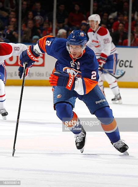 Mark Streit of the New York Islanders skates against the Montreal Canadiens at Nassau Veterans Memorial Coliseum on March 5 2013 in Uniondale New...