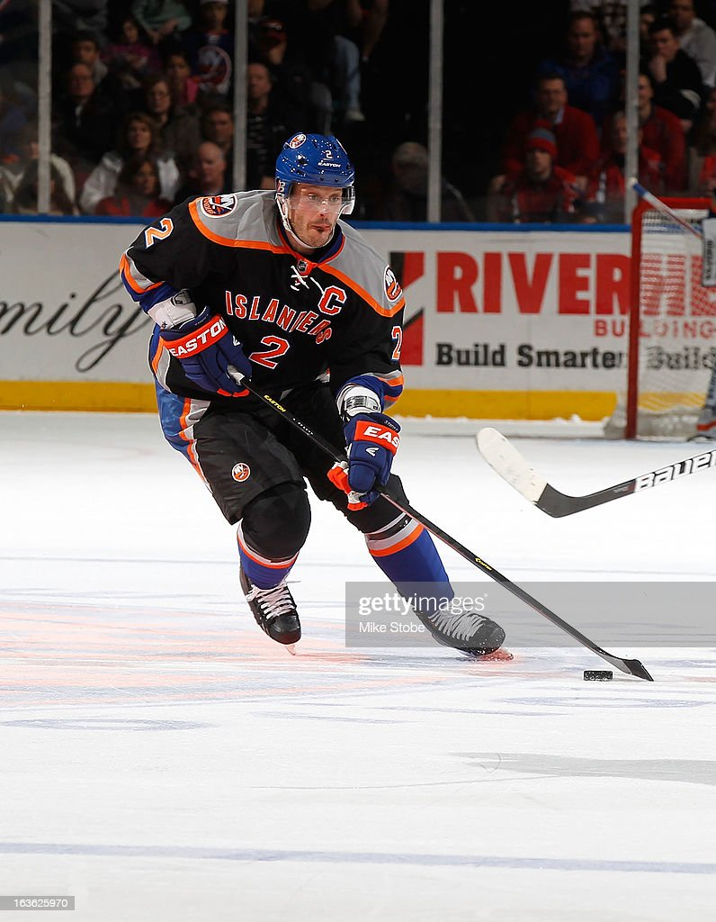 Mark Streit #2 of the New York Islanders skates against the Washington Capitals at Nassau Veterans Memorial Coliseum on March 9, 2013 in Uniondale, New York. The Islanders defeated the Capitals 5-2.