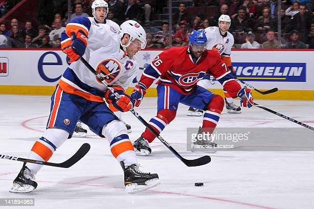 Mark Streit of the New York Islanders skates in on the Montreal Canadiens' net as PK Subban follows the play during the NHL game on March 17 2012 at...