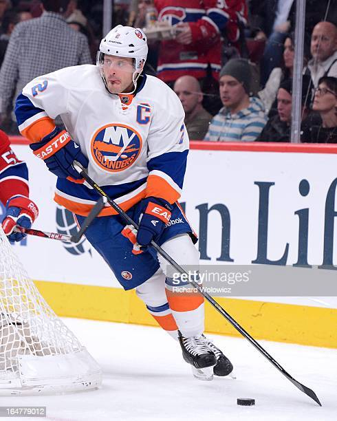 Mark Streit of the New York Islanders skates with the puck during the NHL game against the Montreal Canadiens at the Bell Centre on February 21 2013...