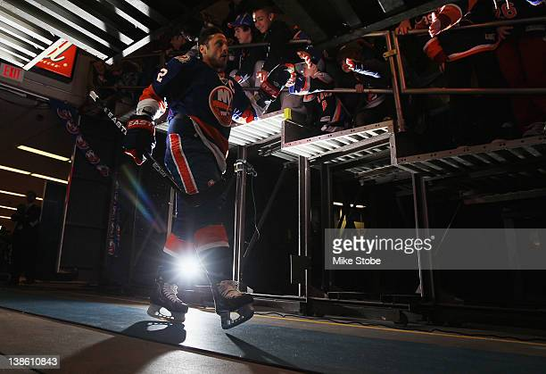 Mark Streit of the New York Islanders walks out onto the ice for warmups prior to the game against the Montreal Canadiens at Nassau Veterans Memorial...