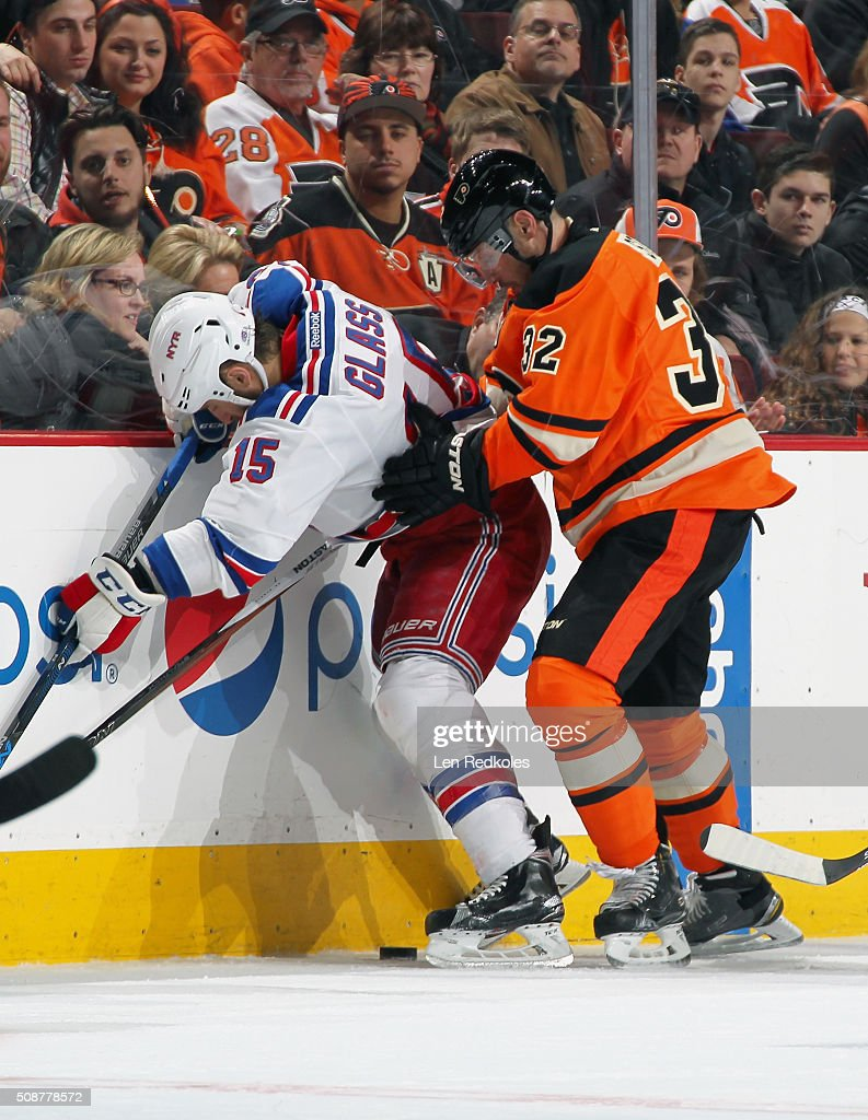 <a gi-track='captionPersonalityLinkClicked' href=/galleries/search?phrase=Mark+Streit&family=editorial&specificpeople=636976 ng-click='$event.stopPropagation()'>Mark Streit</a> #32 of the Philadelphia Flyers battles along the boards for the loose puck with <a gi-track='captionPersonalityLinkClicked' href=/galleries/search?phrase=Tanner+Glass&family=editorial&specificpeople=4596666 ng-click='$event.stopPropagation()'>Tanner Glass</a> #15 of the New York Rangers on February 6, 2016 at the Wells Fargo Center in Philadelphia, Pennsylvania. The Rangers went on to defeat the Flyers 3-2 in a shootout.