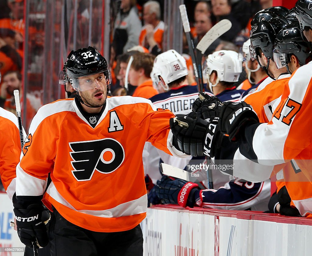 Mark Streit of the Philadelphia Flyers celebrates his goal with teammates on the bench after he scored in the first period against the Columbus Blue...