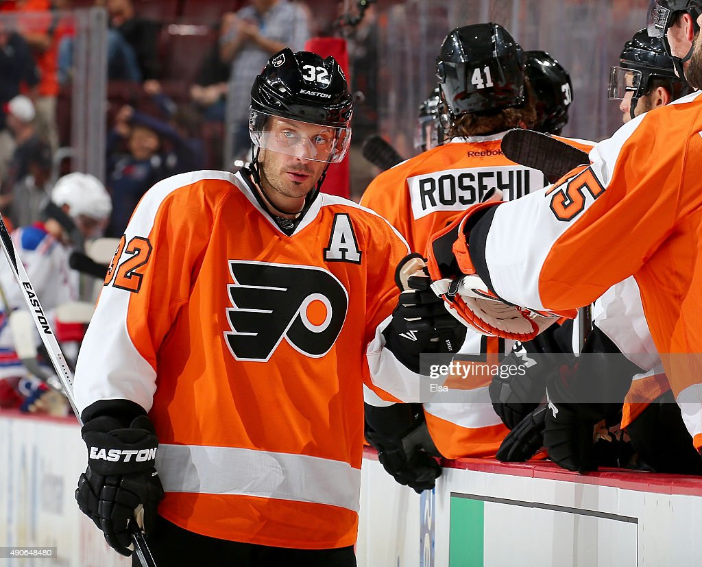 Mark Streit of the Philadelphia Flyers celebrates with teammates on the bench in the third period against the New York Rangers on April 7 2015 at the...