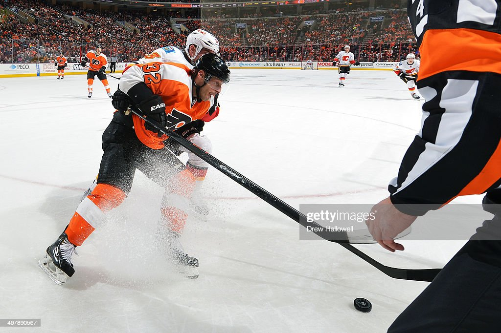 <a gi-track='captionPersonalityLinkClicked' href=/galleries/search?phrase=Mark+Streit&family=editorial&specificpeople=636976 ng-click='$event.stopPropagation()'>Mark Streit</a> #32 of the Philadelphia Flyers gets checked from behind by <a gi-track='captionPersonalityLinkClicked' href=/galleries/search?phrase=Mike+Cammalleri&family=editorial&specificpeople=634009 ng-click='$event.stopPropagation()'>Mike Cammalleri</a> #13 of the Calgary Flames at the Wells Fargo Center on February 8, 2014 in Philadelphia, Pennsylvania. The Flyers won 2-1.
