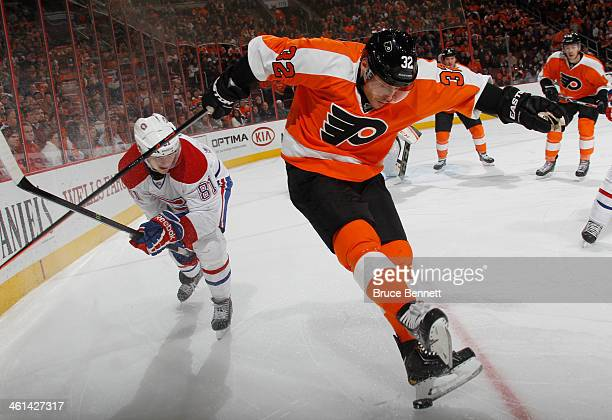 Mark Streit of the Philadelphia Flyers kicks the puck away from Lars Eller of the Montreal Canadiens during the first period at the Wells Fargo...