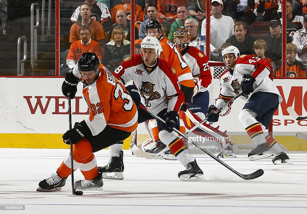 <a gi-track='captionPersonalityLinkClicked' href=/galleries/search?phrase=Mark+Streit&family=editorial&specificpeople=636976 ng-click='$event.stopPropagation()'>Mark Streit</a> #32 of the Philadelphia Flyers moves the puck in front of Shawn Matthias #18 of the Florida Panthers at the Wells Fargo Center on October 8, 2013 in Philadelphia, Pennsylvania.