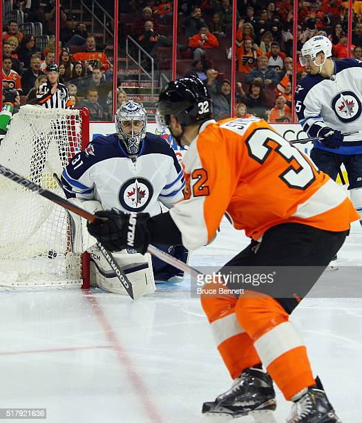 Mark Streit of the Philadelphia Flyers scores at 41 seconds of the second period against Ondrej Pavelec of the Winnipeg Jets at the Wells Fargo...