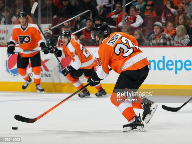 Mark Streit of the Philadelphia Flyers skates the puck against the Montreal Canadiens on December 12 2013 at the Wells Fargo Center in Philadelphia...