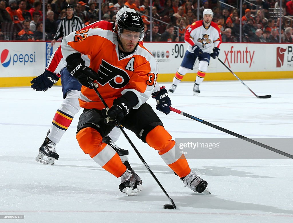 Mark Streit of the Philadelphia Flyers takes the puck in the second period against the Florida Panthers on December 18 2014 at the Wells Fargo Center...