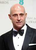 Mark Strong poses in the winners room at the EE British Academy Film Awards at The Royal Opera House on February 8 2015 in London England