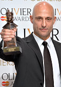 Mark Strong poses in the winners room at The Olivier Awards at The Royal Opera House on April 12 2015 in London England