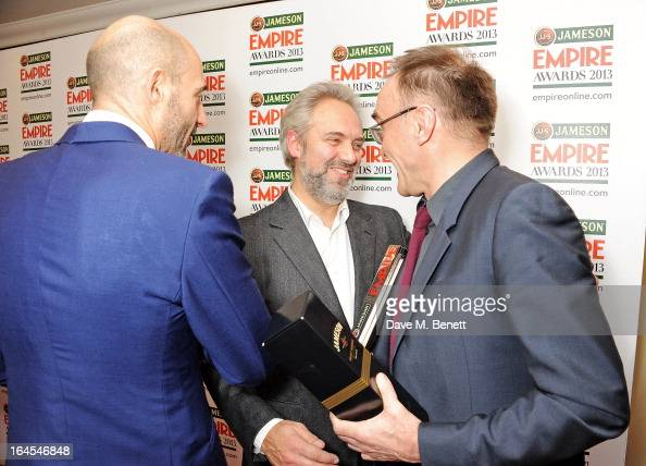 Mark Strong Sam Mendes and Danny Boyle pose in the press room at the Jameson Empire Awards 2013 at The Grosvenor House Hotel on March 24 2013 in...
