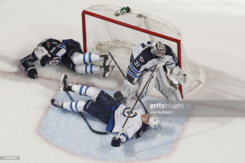 Mark Stuart #5 dislodges the net as Goaltender Ondrej Pavelec #31 guards the post and <a gi-track='captionPersonalityLinkClicked' href=/galleries/search?phrase=Mark+Scheifele&family=editorial&specificpeople=7342540 ng-click='$event.stopPropagation()'>Mark Scheifele</a> #55 of the Winnipeg Jets lies on his back during second period action against the Florida Panthers at the BB&T Center on December 5, 2013 in Sunrise, Florida. The Panthers defeated the Jets 5-2.