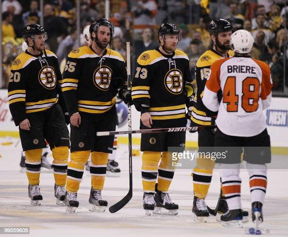 Mark Stuart Michael Ryder Johnny Boychuk and Daniel Paille of the Boston Bruins congratulate Danny Briere of the Philadelphia Flyers in Game Seven of...