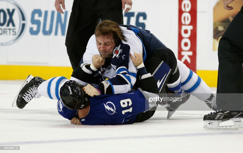 Mark Stuart #5 of the Winnipeg Jets fights <a gi-track='captionPersonalityLinkClicked' href=/galleries/search?phrase=B.J.+Crombeen&family=editorial&specificpeople=4505846 ng-click='$event.stopPropagation()'>B.J. Crombeen</a> #19 of the Tampa Bay Lightning during the first period at Tampa Bay Times Forum on December 7, 2013 in Tampa, Florida.