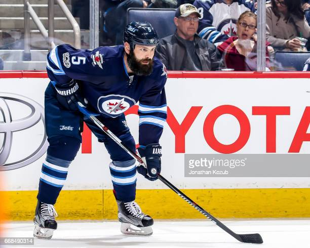 Mark Stuart of the Winnipeg Jets gets set during a first period faceoff against the Nashville Predators at the MTS Centre on April 8 2017 in Winnipeg...