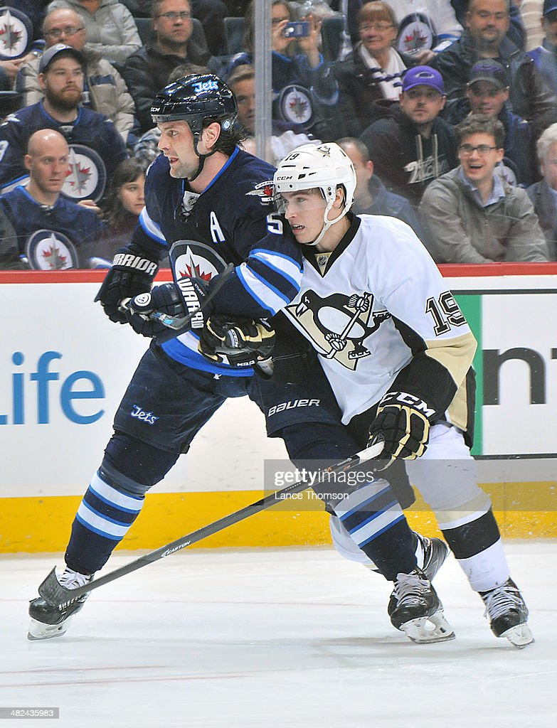 Mark Stuart #5 of the Winnipeg Jets jockeys for position against <a gi-track='captionPersonalityLinkClicked' href=/galleries/search?phrase=Beau+Bennett&family=editorial&specificpeople=7029341 ng-click='$event.stopPropagation()'>Beau Bennett</a> #19 of the Pittsburgh Penguins as they keep an eye on the play during third period action at the MTS Centre on April 3, 2014 in Winnipeg, Manitoba, Canada.