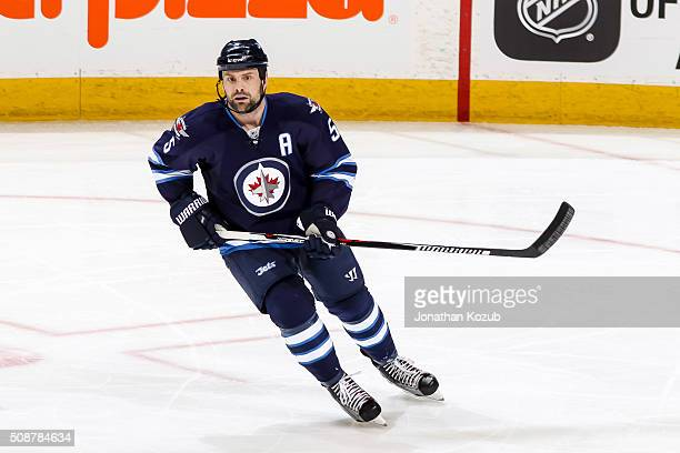 Mark Stuart of the Winnipeg Jets keeps an eye on the play during third period action against the Dallas Stars at the MTS Centre on February 2 2016 in...
