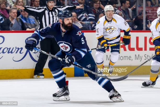 Mark Stuart of the Winnipeg Jets keeps an eye on the play during first period action against the Nashville Predators at the MTS Centre on April 8...