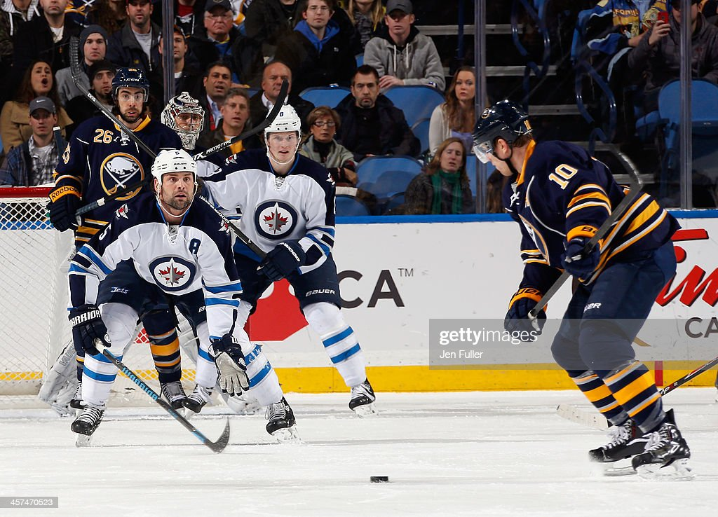 Mark Stuart #5 of the Winnipeg Jets looks to block the shot of <a gi-track='captionPersonalityLinkClicked' href=/galleries/search?phrase=Christian+Ehrhoff&family=editorial&specificpeople=214788 ng-click='$event.stopPropagation()'>Christian Ehrhoff</a> #10 of the Buffalo Sabres at First Niagara Center on December 17, 2013 in Buffalo, New York. <a gi-track='captionPersonalityLinkClicked' href=/galleries/search?phrase=Jacob+Trouba&family=editorial&specificpeople=8050718 ng-click='$event.stopPropagation()'>Jacob Trouba</a> #8 and Ondrej Pavelec #31 of Winnipeg battle with <a gi-track='captionPersonalityLinkClicked' href=/galleries/search?phrase=Matt+Moulson&family=editorial&specificpeople=3365493 ng-click='$event.stopPropagation()'>Matt Moulson</a> #26 of Buffalo in front of the net. Buffalo defeated Winnipeg 4-2.