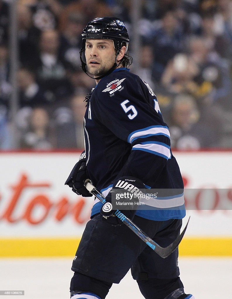 Mark Stuart #5 of the Winnipeg Jets skates down the ice during the second period of the NHL game against the Boston Bruins at the MTS Centre on April 10, 2014 in Winnipeg, Manitoba, Canada.