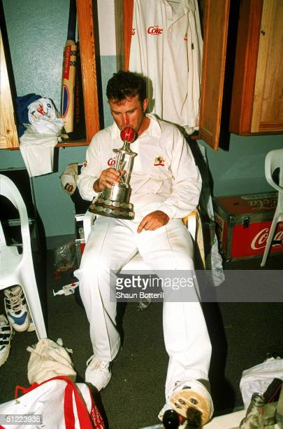 Mark Taylor of Australia kisses the Frank Worrell Trophy after the teams victory during the 4th Test Match between the West Indies and Australia May...