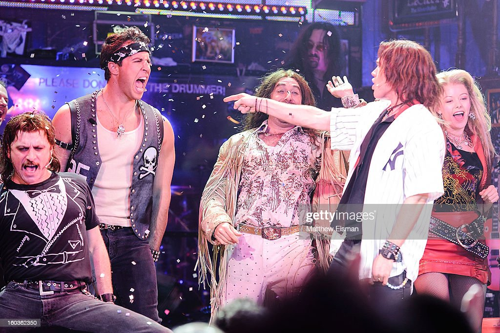 Mark Teixeira (L) #25 of the New York Yankees makes his broadway debut in a walk-on role at 'Rock Of Ages' on Broadway at Helen Hayes Theatre on January 29, 2013 in New York City.