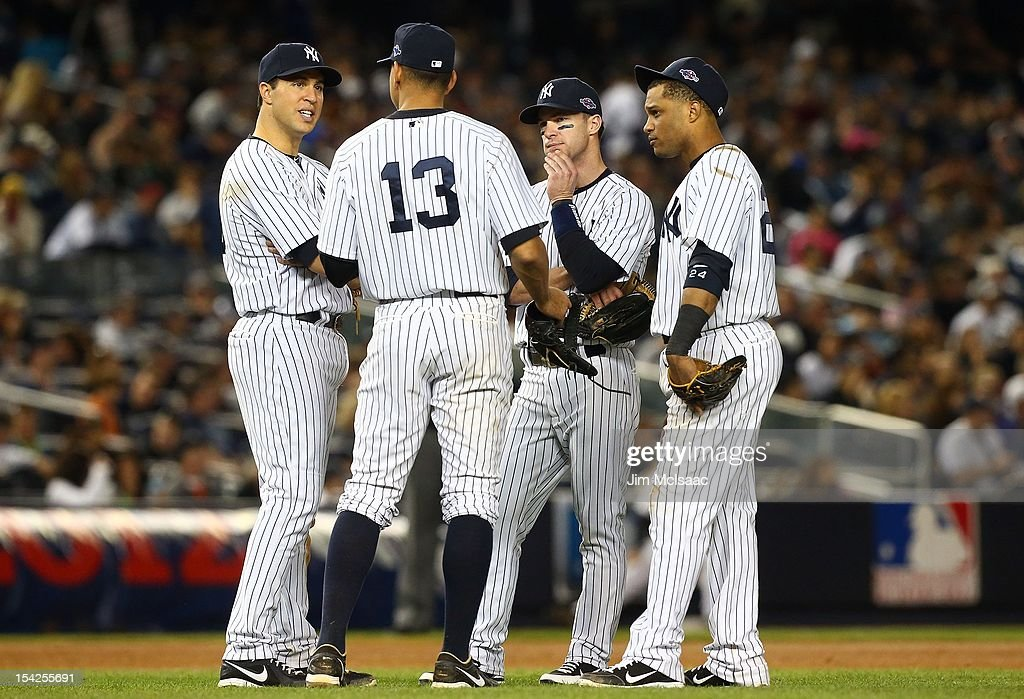 Mark Teixeira #25, Alex Rodriguez #13, Jayson Nix #17 and Robinson Cano #24 of the New York Yankees talk during a pitching change in Game Two of the American League Championship Series against the Detroit Tigers at Yankee Stadium on October 14, 2012 in the Bronx borough of New York City, New York.. The Tigers defeated the Yankees 3-0.