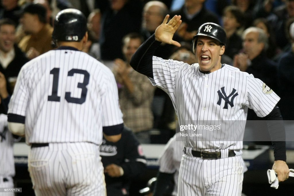 Mark Teixeira and Alex Rodriguez of the New York Yankees celebrate after they scored on a 2run double in the bottom of the fifht inning against the...