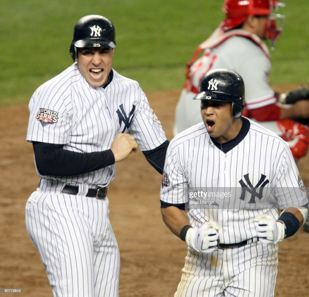 Mark Teixeira and Alex Rodriguez of the New York Yankees celebrate after scoring in the bottom of the fifth inning of Game Six of the 2009 MLB World...