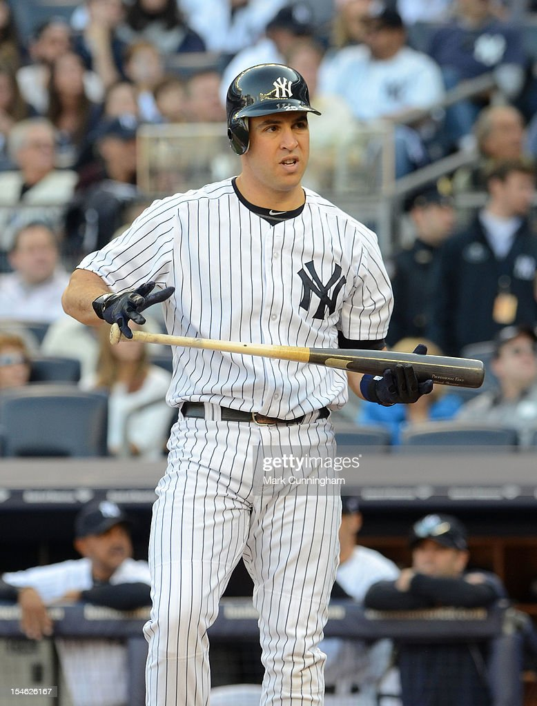 Mark Teixeira #25 of the New York Yankees bats against the Detroit Tigers during Game Two of the American League Championship Series at Yankee Stadium on October 14, 2012 in the Bronx borough of New York City, New York. The Tigers defeated the Yankees 3-0.