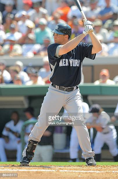 Mark Teixeira of the New York Yankees bats against the Detroit Tigers during the spring training game at Joker Marchant Stadium on March 11 2009 in...