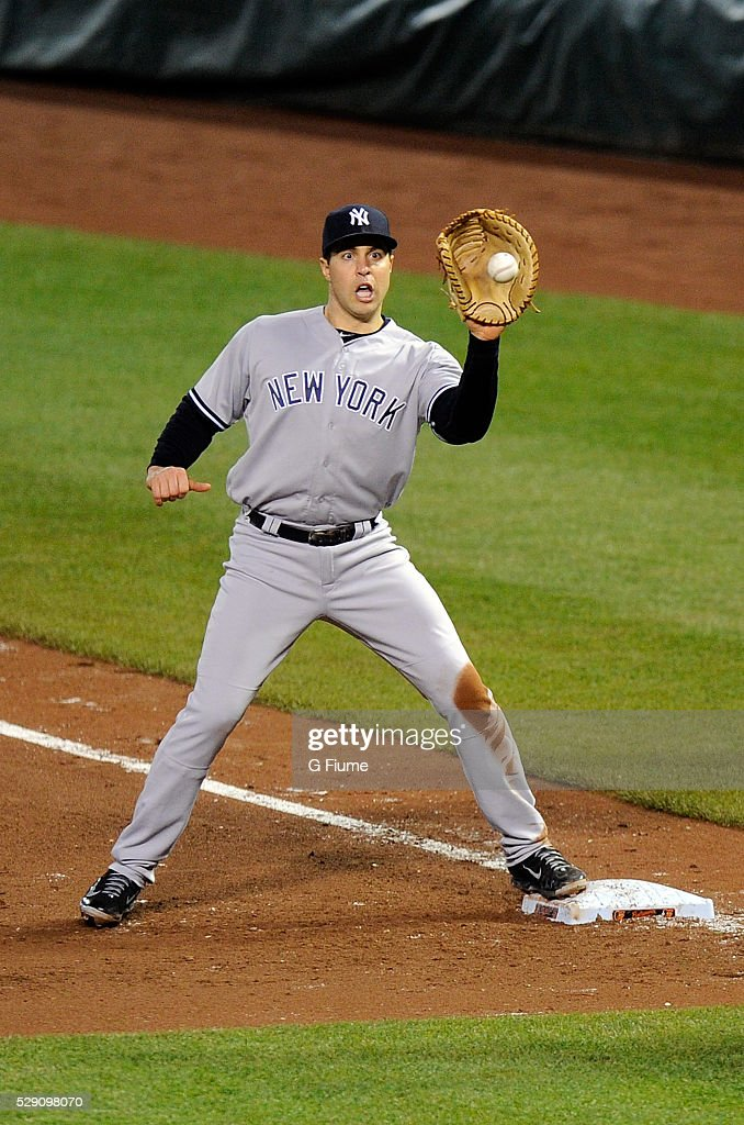 <a gi-track='captionPersonalityLinkClicked' href=/galleries/search?phrase=Mark+Teixeira&family=editorial&specificpeople=209239 ng-click='$event.stopPropagation()'>Mark Teixeira</a> #25 of the New York Yankees catches the ball at first base against the Baltimore Orioles at Oriole Park at Camden Yards on May 5, 2016 in Baltimore, Maryland.