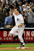 Mark Teixeira of the New York Yankees celebrates after hitting a walk off home run in the eleventh inning against the Minnesota Twins in Game Two of...