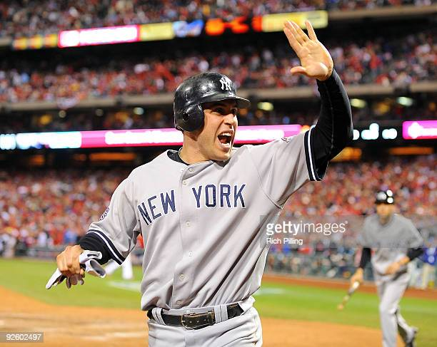 Mark Teixeira of the New York Yankees celebrates after scoring a run in the top of the ninth inning of Game Four of the 2009 MLB World Series at...