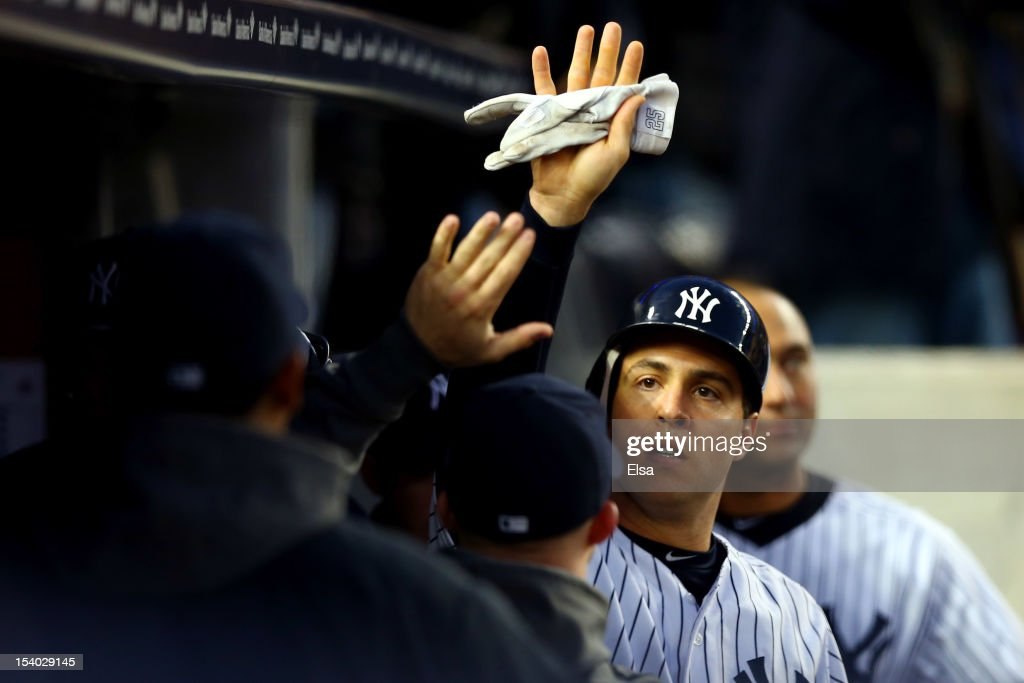 Mark Teixeira #25 of the New York Yankees celebrates after scoring in the fifth inning against the Baltimore Orioles during Game Five of the American League Division Series at Yankee Stadium on October 12, 2012 in New York, New York.