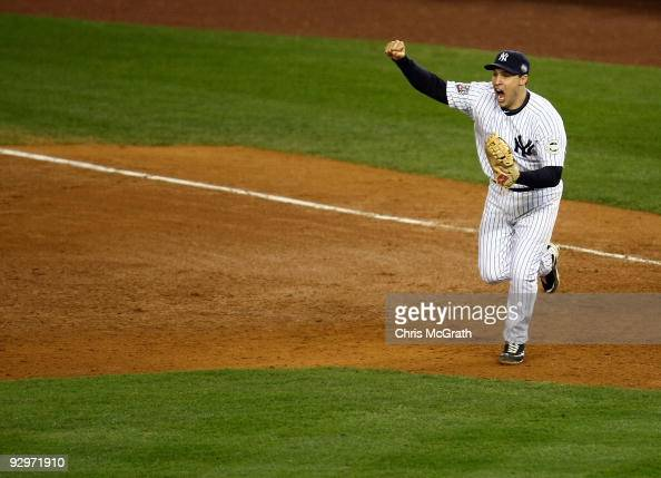 Mark Teixeira of the New York Yankees celebrates after the final out of the Yankees' 73 win against the Philadelphia Phillies in Game Six of the 2009...